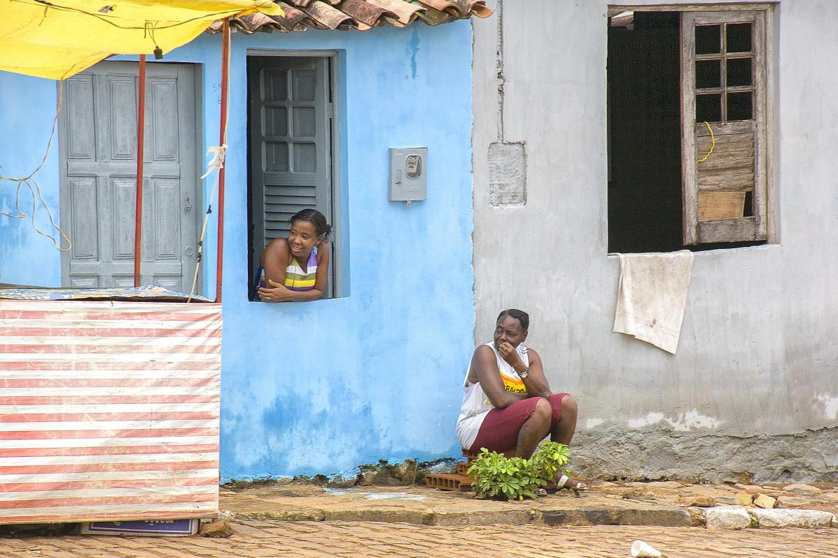 Two women looking to the street
